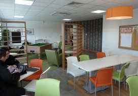 Break out area with pool table, relaxing soft furniture , decoration to walls and bespoke screens made form laminated MDF