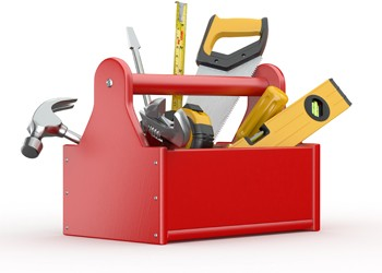 Toolbox containing joinery tools , saw, tape measure, spirit level, hammer and screw driver