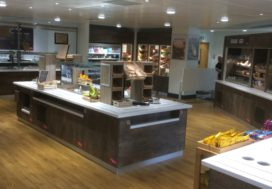 Overview showing several counters finished in Corian Antarctica grey brown metal laminate as per Santander standard spec