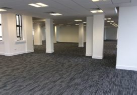 New carpet tiles and suspended ceiling with new LED panel lights